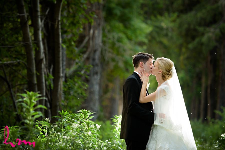 Sabrina + Winston kissing in forest Bellamere Winery Event Centre London ON Wedding Photography