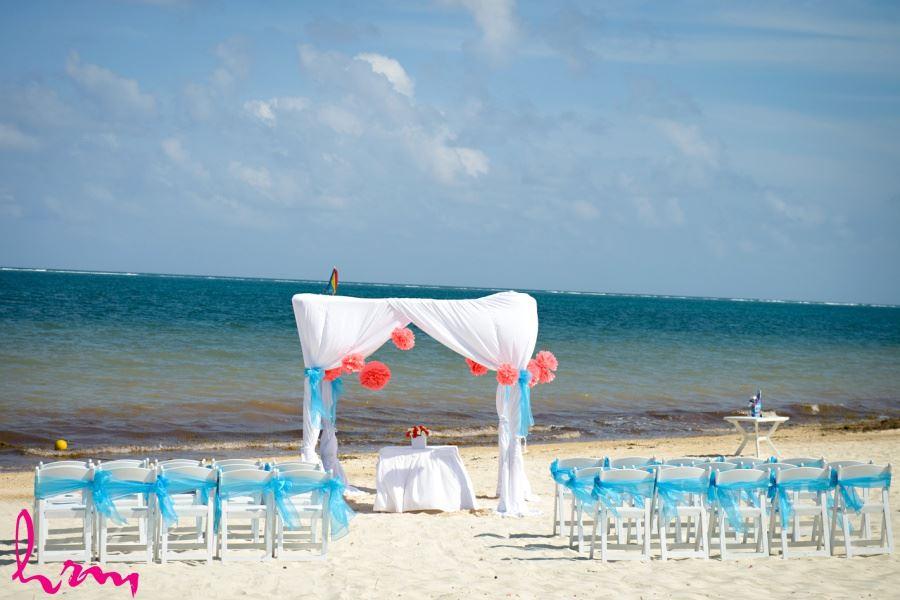Destination wedding ceremony decor pompoms