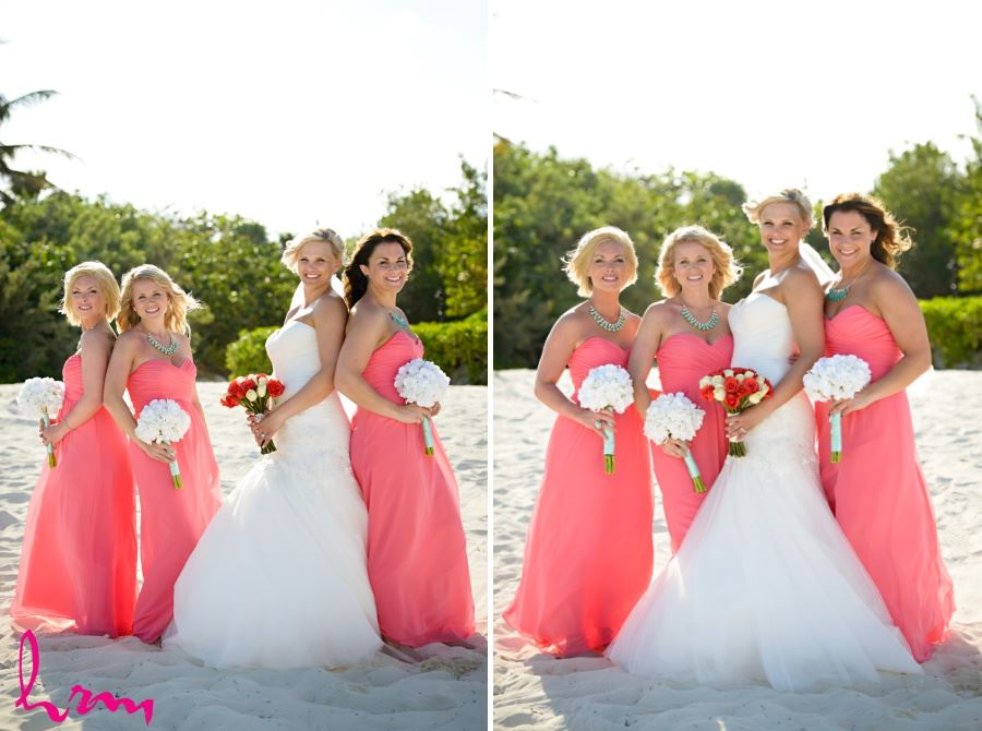 Bridesmaids in coral dresses with white bouquets
