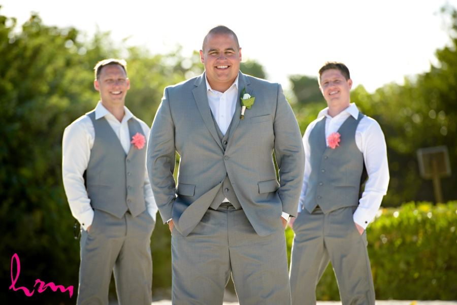 Groomsmen in gray suits with fabric boutineers