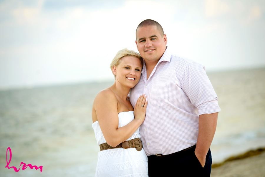 Destination wedding day after bride and groom couple pics on beach