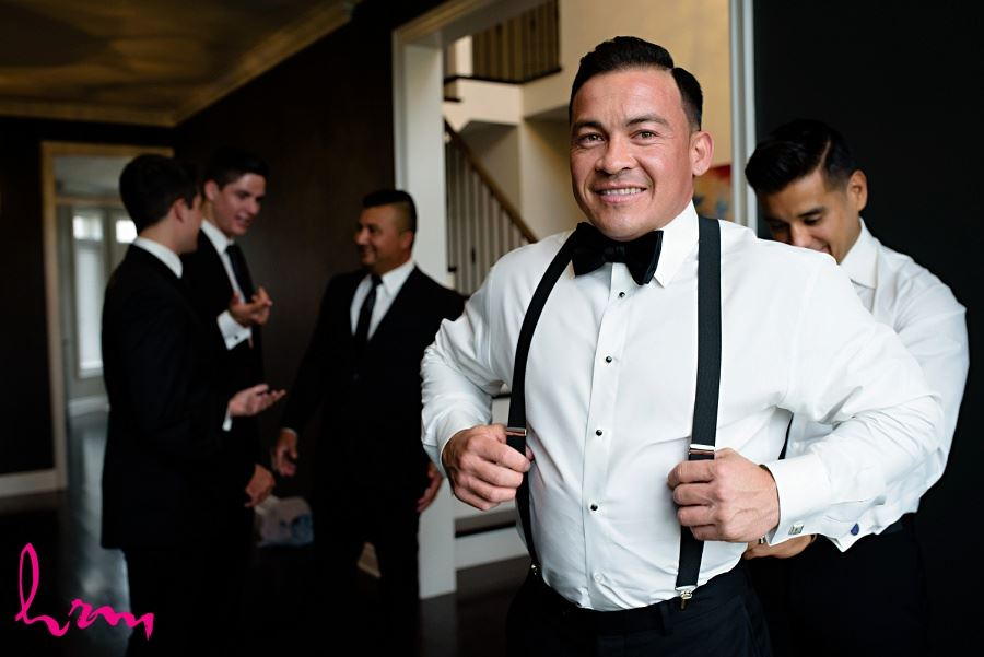 Jose adjusting suspenders London ON Wedding Photography