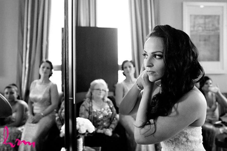 Lauren in black and white fixing earrings London ON Wedding Photography