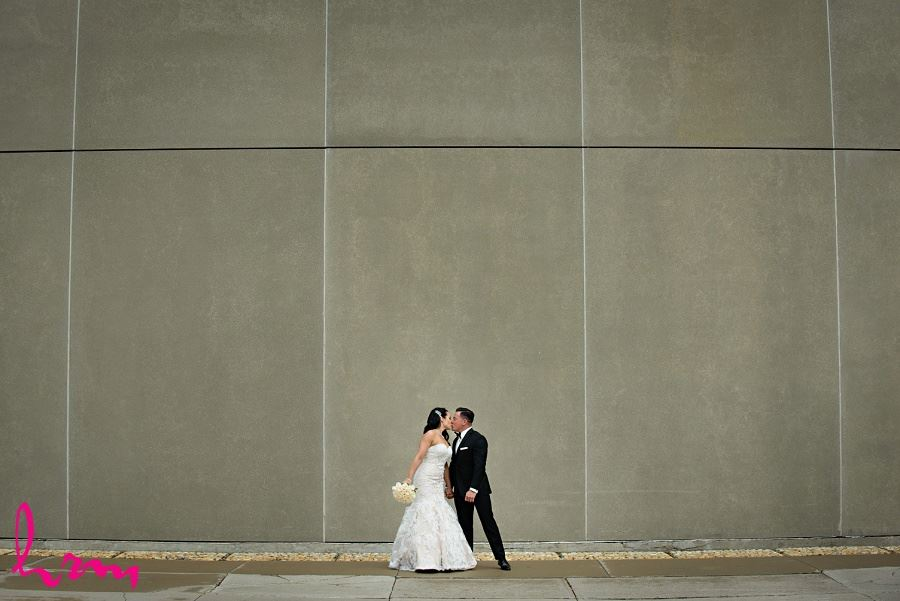 Lauren + Jose  sharing a kiss at Museum London, London ON Wedding Photography