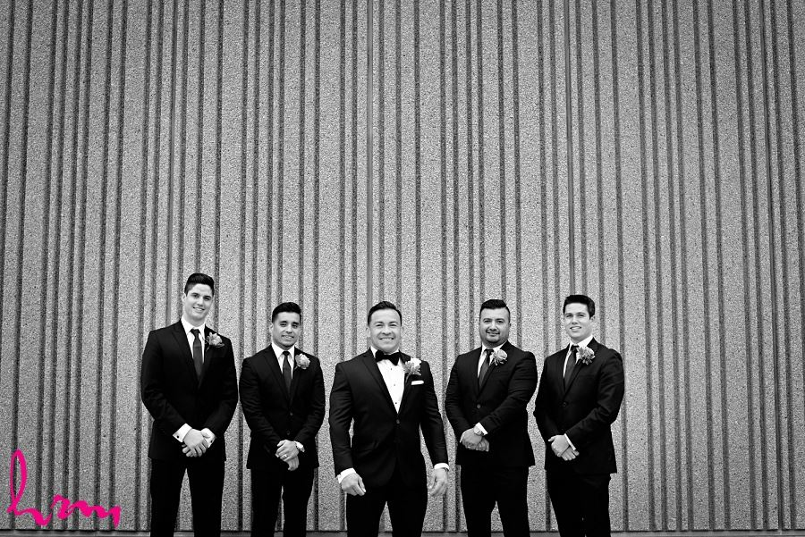 Black and white photo of Jose and groomsmen outside Museum London London ON Wedding Photography