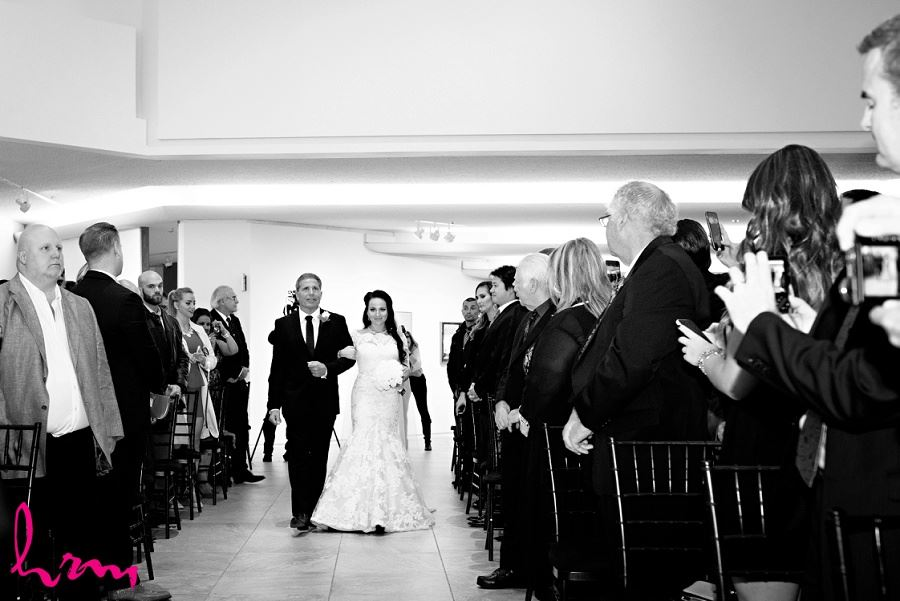 Lauren walking down the aisle at Museum London London ON Wedding Photography
