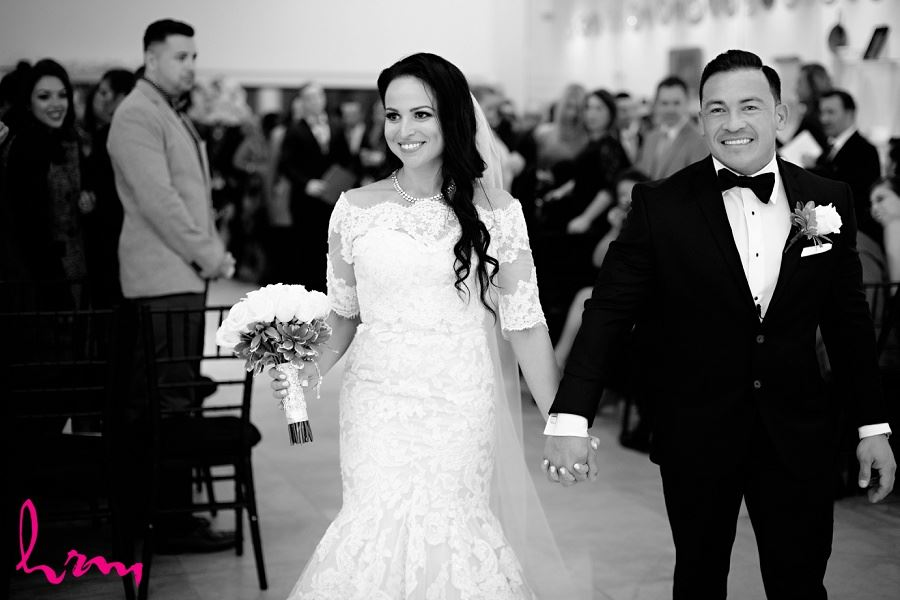Lauren + Jose walking down the aisle at Museum London, London ON Wedding Photography