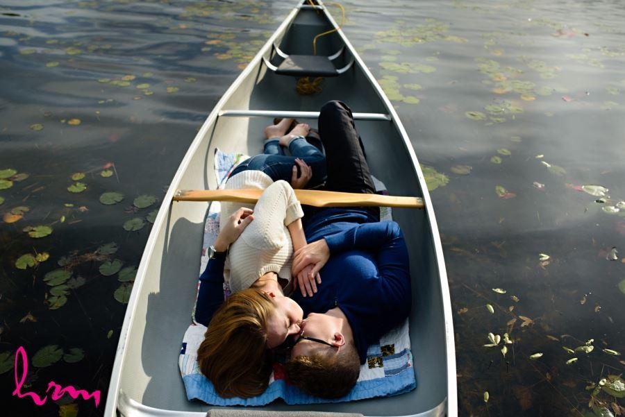 muskoka ontario engagement session canoe kissing