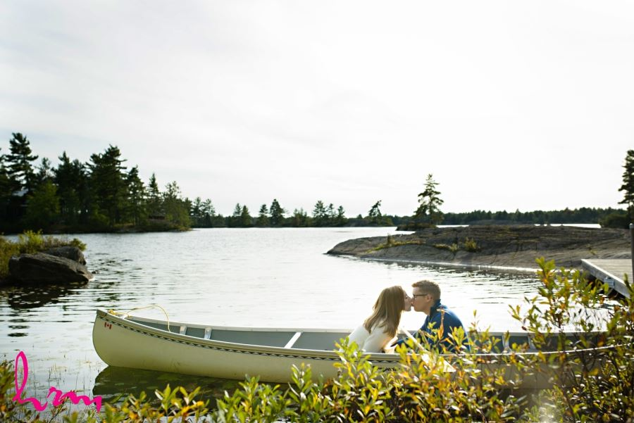engagement session kissing in canoe