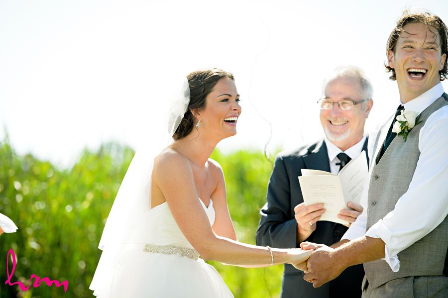 Laughing during ceremony at Purple Hill Country Farms London ON Wedding Photography