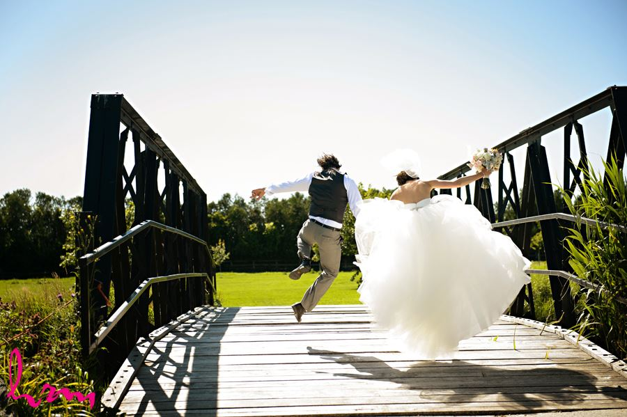 Leigh + Pete jumping for joy Purple Hill Country Farms London ON Wedding HRM Photography