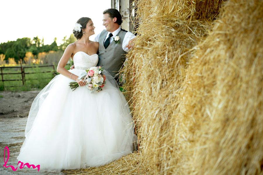 Leigh and Pete by hay bales Purple Hill Country Farms London ON Wedding Photography