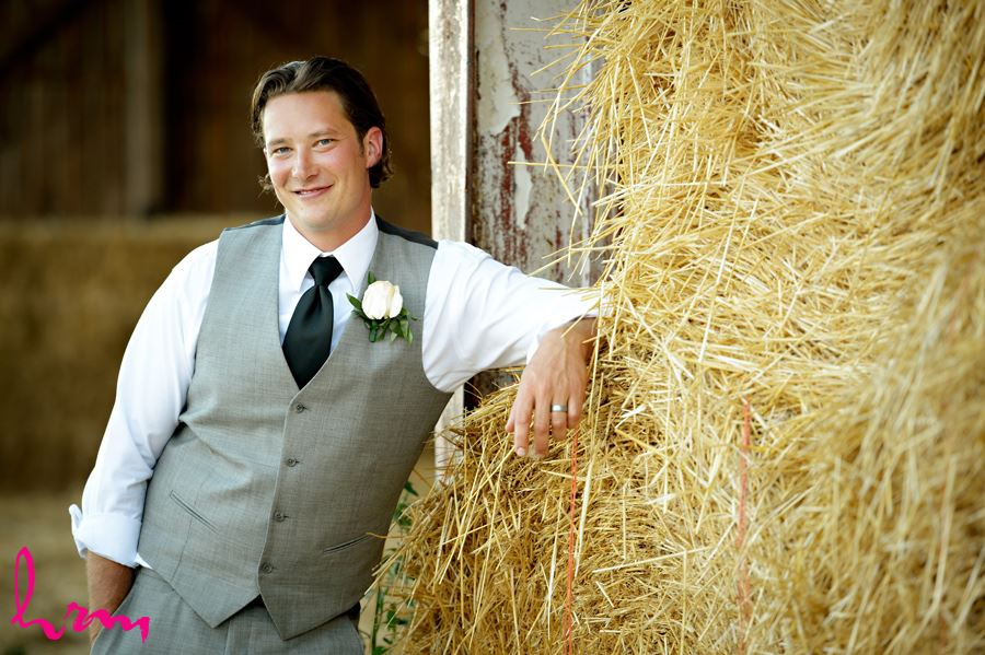 Pete by hay bales Purple Hill Country Farms London ON Wedding Photography