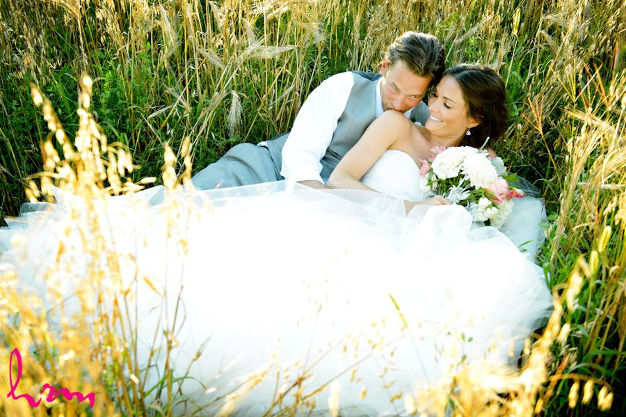 Leigh and Pete in laying in field Purple Hill Country Farms London ON Wedding Photography