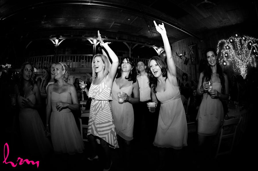 Black and white photo dancing with guests Purple Hill Country Farms London ON Wedding Photography