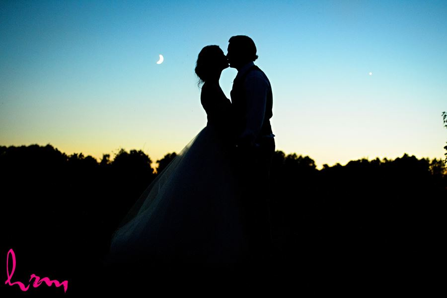 Leigh and Pete kiss in moonlight Purple Hill Country Farms London ON Wedding Photography
