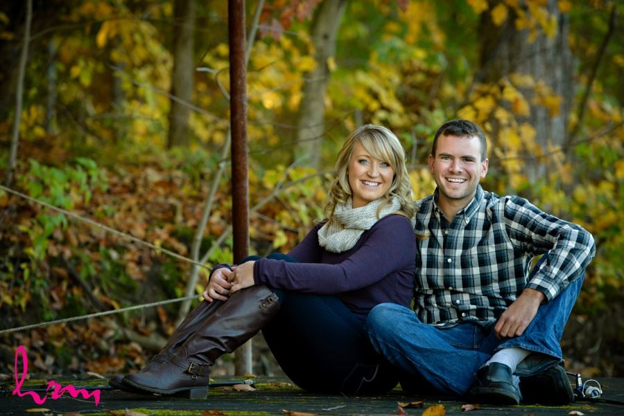 Fall engagement session in wooded area fishing