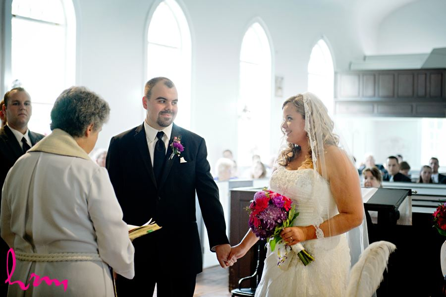 Mallory and Will at the altar St. Thomas ON Wedding Photography