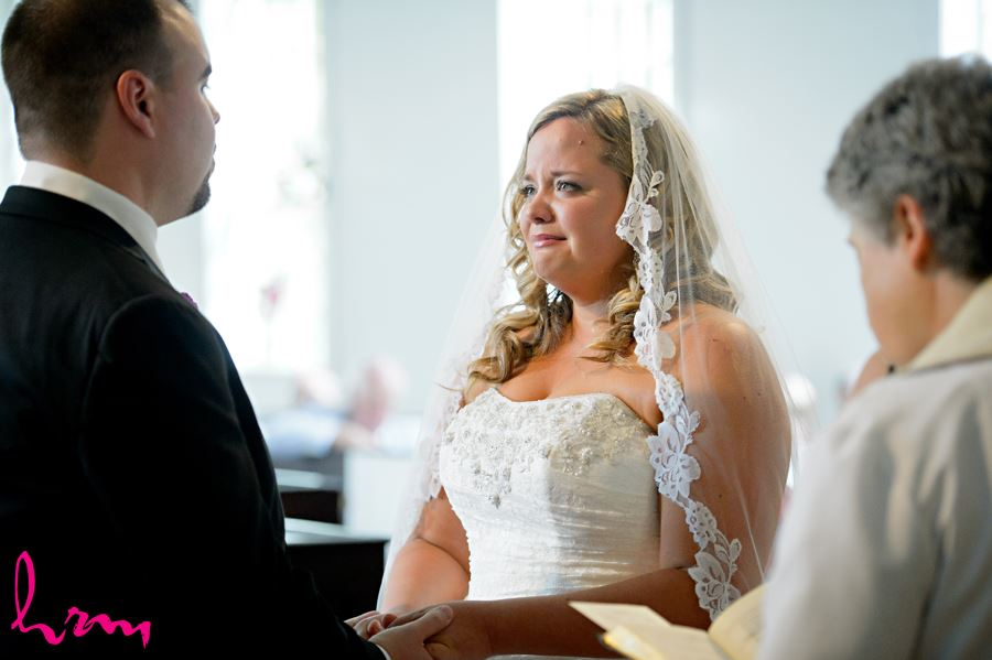 Exchanging vows at The Old St. Thomas Church St. Thomas ON Wedding Photography