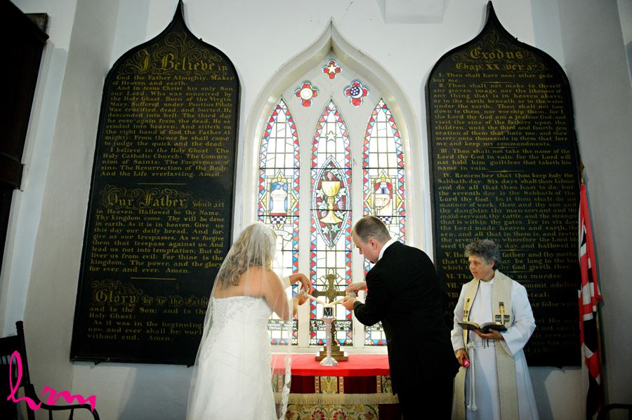 Lighting candles at The Old St. Thomas Church St. Thomas ON Wedding Photography