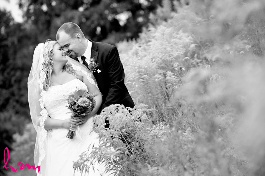 Black and white photo of Mallory and Will in field St. Thomas ON Wedding Photography