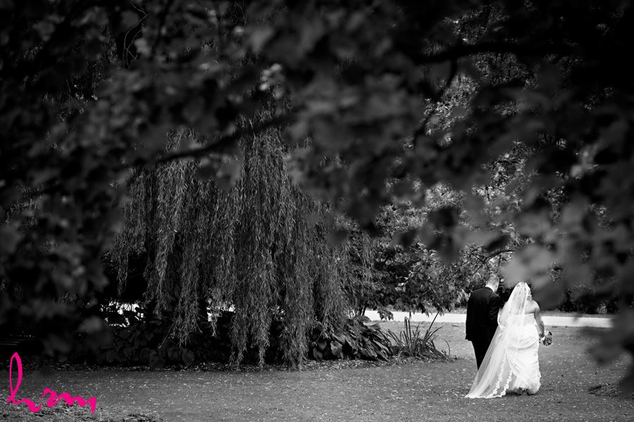 Mallory and Will walk in trees St. Thomas ON Wedding Photography