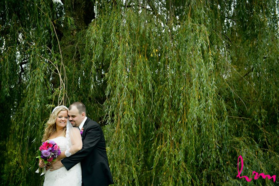 Mallory and Will in trees St. Thomas ON Wedding Photography