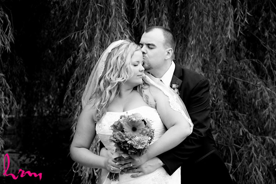 Black and white photo of Mallory and Will in trees St. Thomas ON Wedding Photography