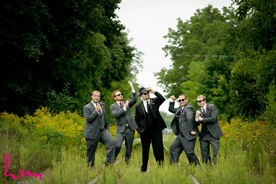 Will and groomsment outside CASO Railway Station St. Thomas ON Wedding Photography