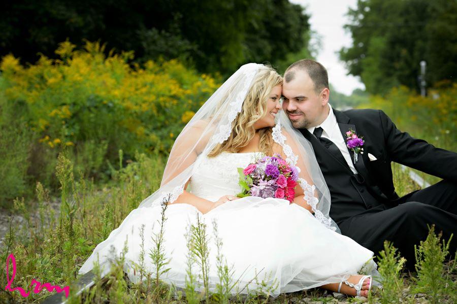 Mallory + Will outside CASO Railway Station St. Thomas ON Wedding Photography