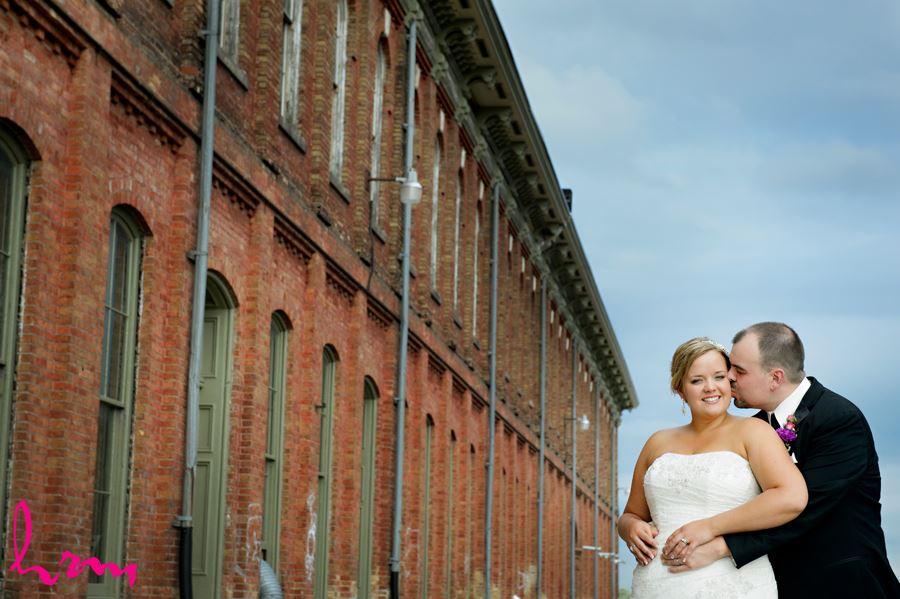 Mallory + Will kiss outside CASO Railway Station St. Thomas ON Wedding Photography