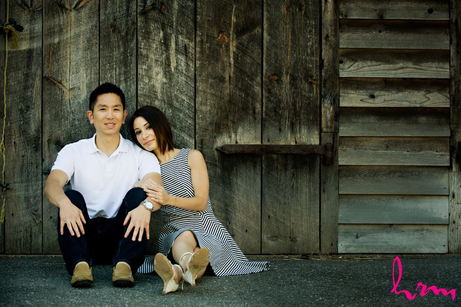 couple sitting in front of wooden background