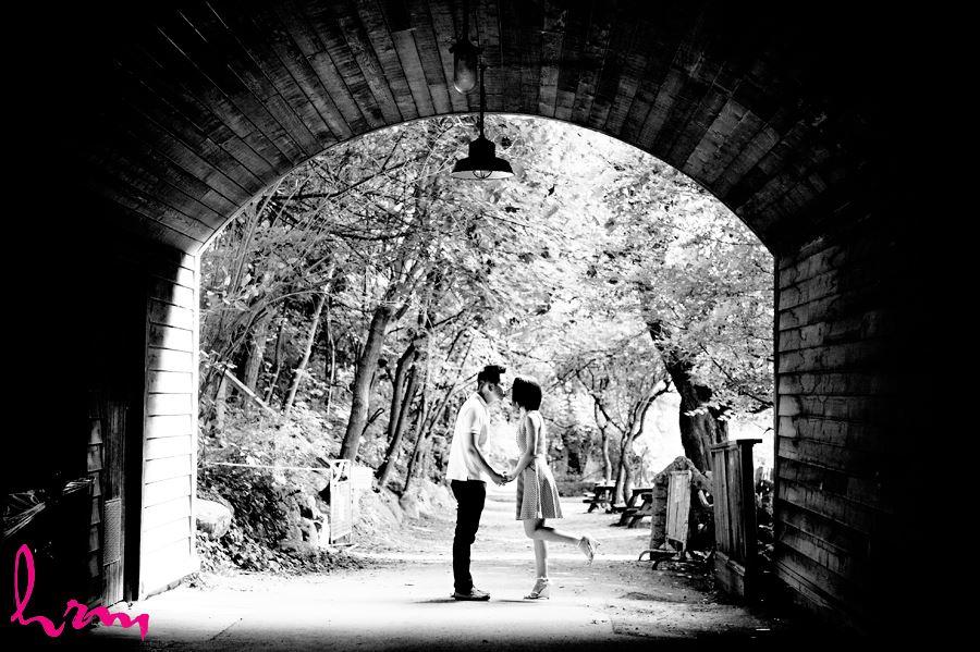 Couple kissing under bridge Riverdale Farm