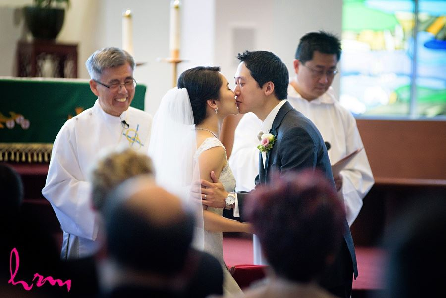 The kiss at Chinese Martyrs Catholic Church Toronto ON Wedding Photography