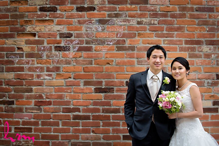 Natalie and Michael by brick wall in Unionville Toronto ON Wedding Photography