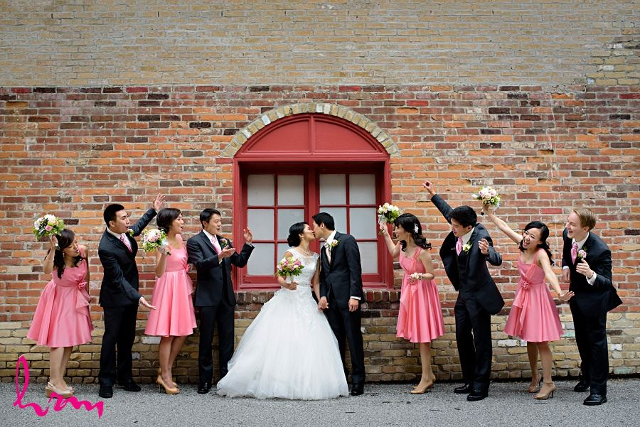 Natalie and Michael kiss by brick wall in Unionville Toronto ON Wedding Photography