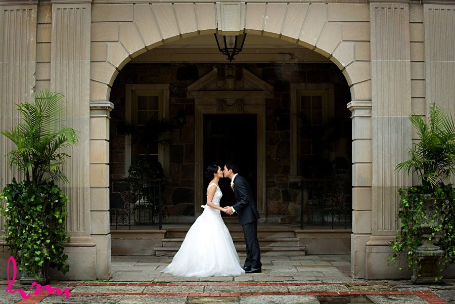 Natalie + Michael kiss outside Graydon Hall Manor Toronto ON Wedding Photography