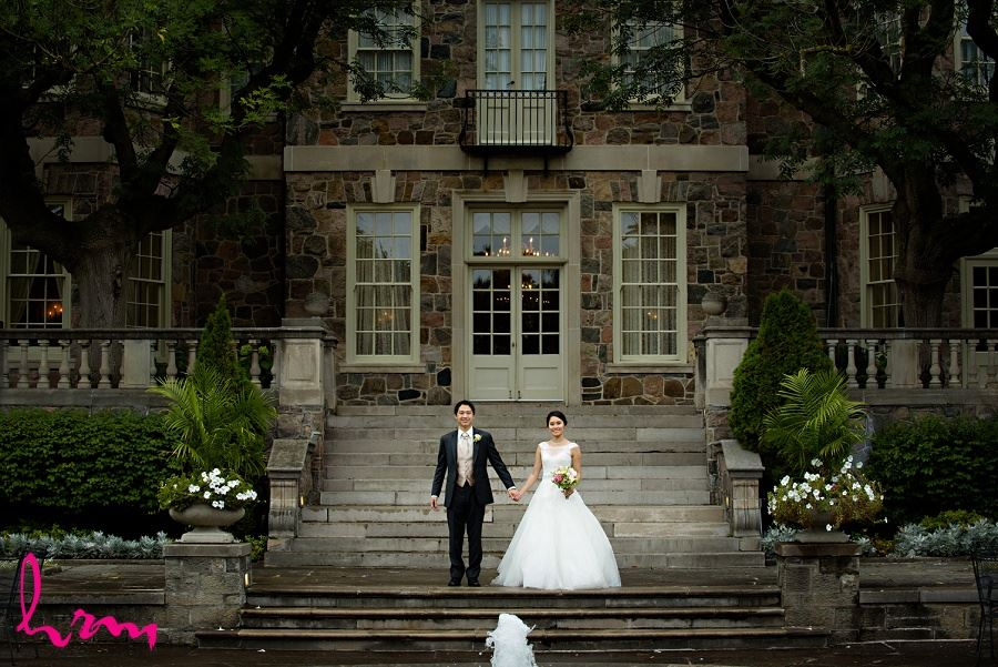 Natalie and Michael by fountains at Graydon Hall Manor Toronto ON Wedding HRM Photography
