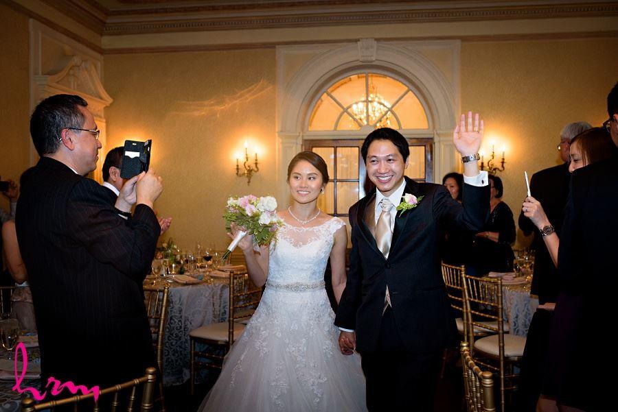 Natalie and Michael enter at Graydon Hall Manor Toronto ON Wedding Photography