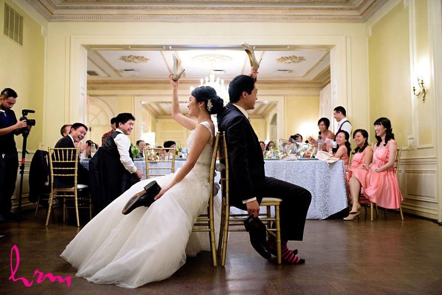 Natalie and Michael play shoe game at Graydon Hall Manor Toronto ON Wedding Photography