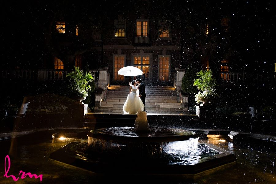 Natalie and Michael in moonlight by fountain at  Graydon Hall Manor Toronto ON Wedding Photography