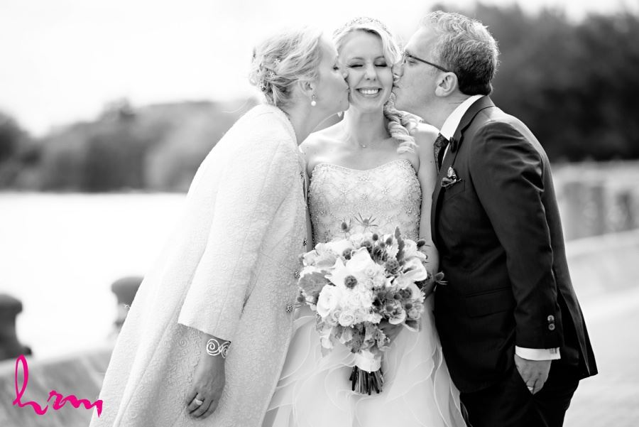 Bride with mother and father wedding day