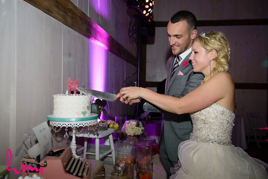 Wedding cake with cutout fondant hearts in white pink and teal