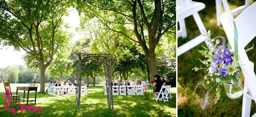 natural outdoor wedding ceremony decor arbor and wildflowers