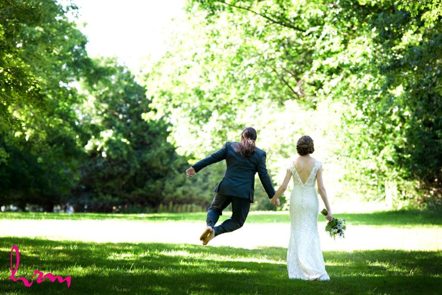 Groom clicking heels together jumping