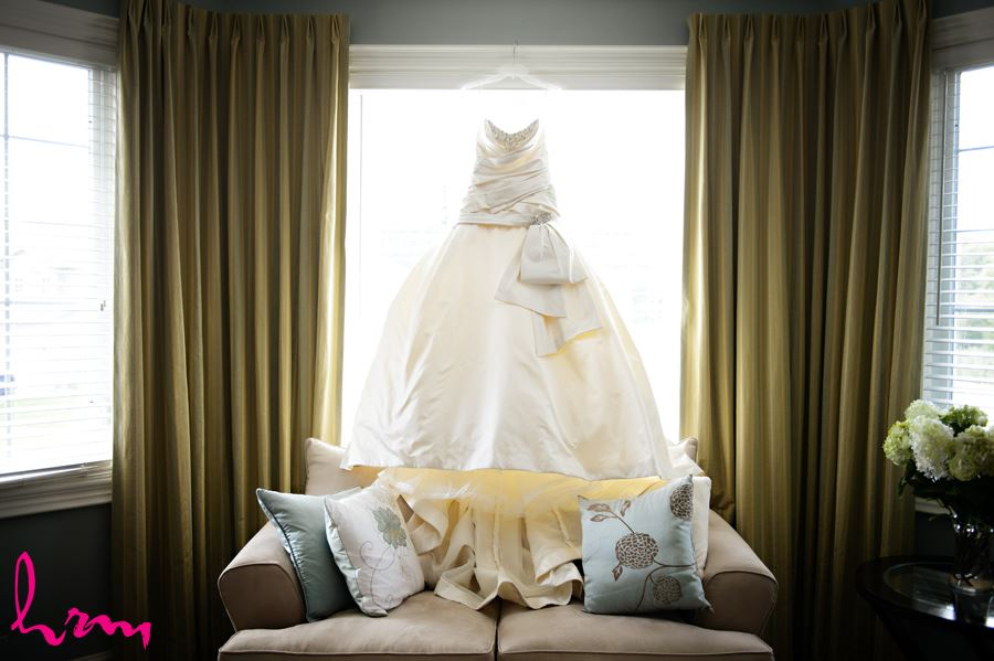 Brides wedding dress in window