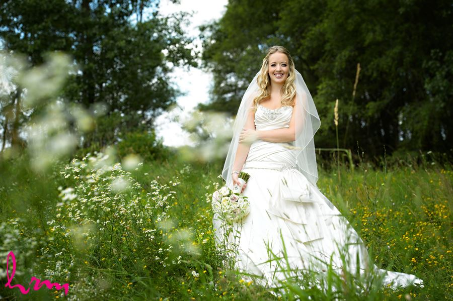 Beautiful bride in field of yellow flowers