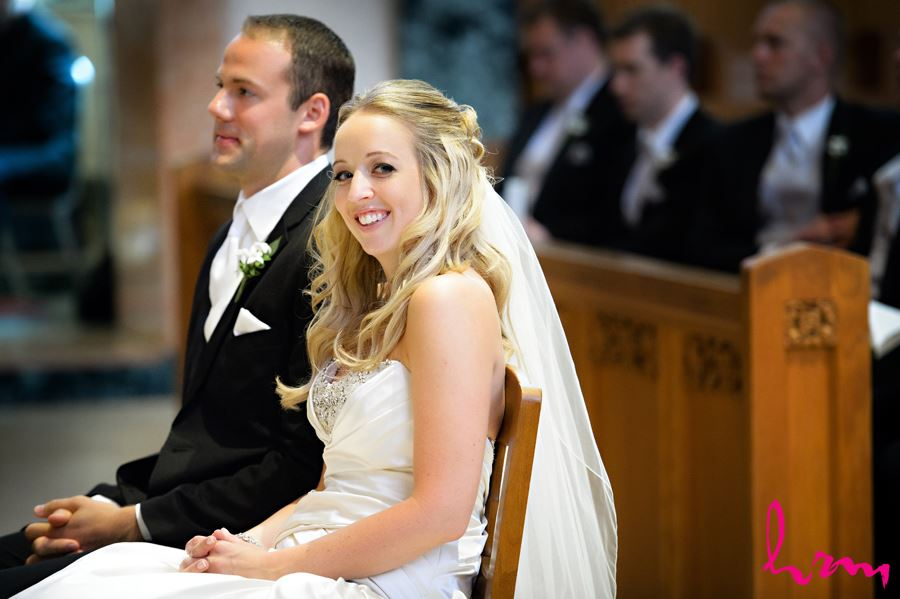 Bride smiling at the end of the alter