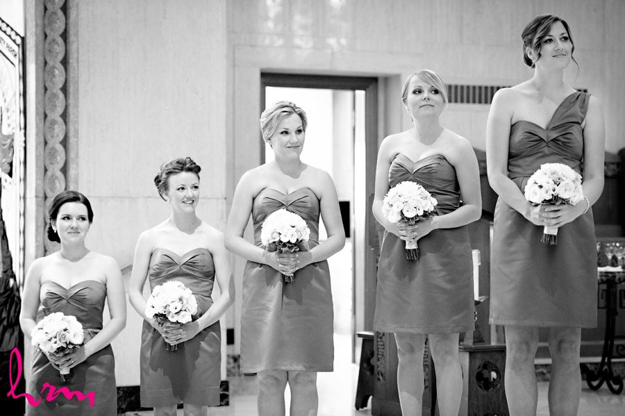 Black and white photo of bridesmaids while watching the bride and groom exchanging vows in London Ontario