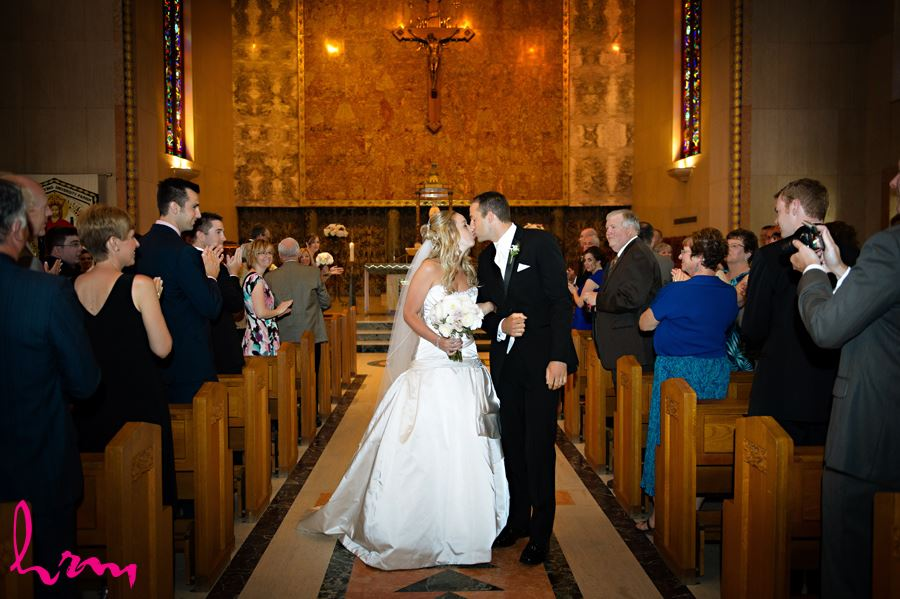 Bride and Groom kiss at Windermere Chapel in London Ontario